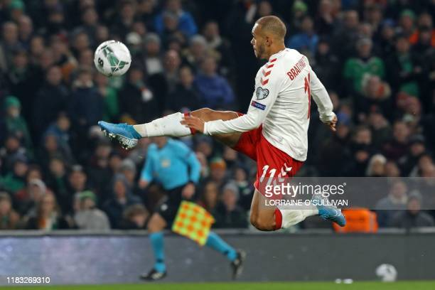 Denmark's striker Martin Braithwaite shoots to score the opening goal of the Group D Euro 2020 football qualification match between Republic of...