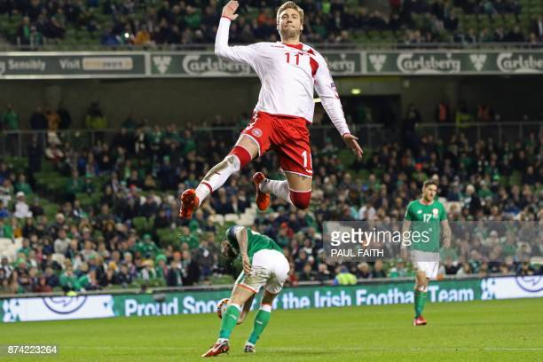 TOPSHOT Denmark's striker Nicklas Bendtner celebrates after scoring their fifth goal from the penalty spot during the FIFA World Cup 2018 qualifying...