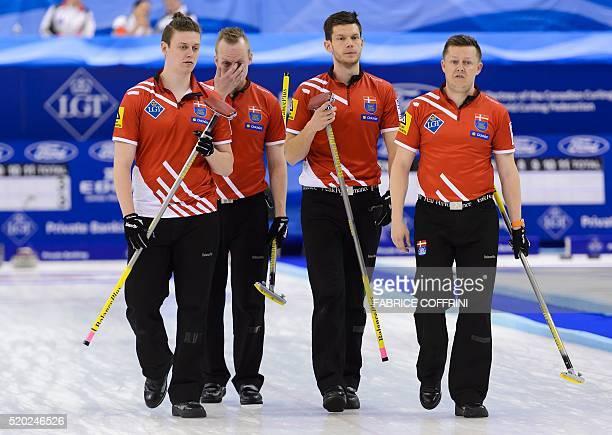 Denmark's team lead Troels Harry second Mikkel Poulsen skip Rasmus Stjerne and third Johnny Frederiksen compete during the gold medal game againt...