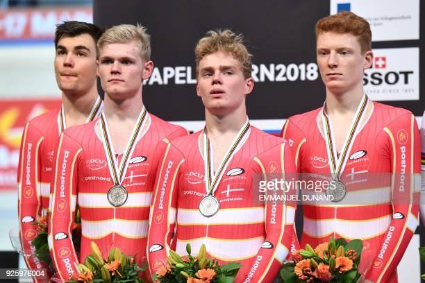 Denmark's team members Casper von Folsach Julius Johansen Niklas Larsen and Frederik Madsen pose on the podium after taking the silver medal in the...
