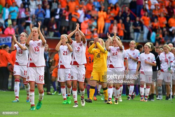 Denmark's team players applaud and react at the end of the UEFA Womens Euro 2017 football tournament final match between Netherlands and Denmark at...