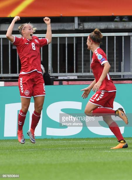 Denmark's Theresa Nielsen celebrates her 12 goal with Katrine Veje during the UEFA Women's EURO quarterfinals soccer match between Germany and...