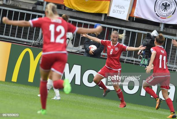 Denmark's Theresa Nielsen celebrates her 12 goal with Stine Larsen and Katrine Veje during the UEFA Women's EURO quarterfinals soccer match between...
