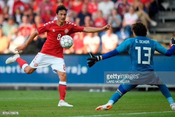 Denmark's Thomas Delaney attempts to score against Mexico's goalkeeper Guillermo Ochoa during the international friendly footbal match Denmark vs...
