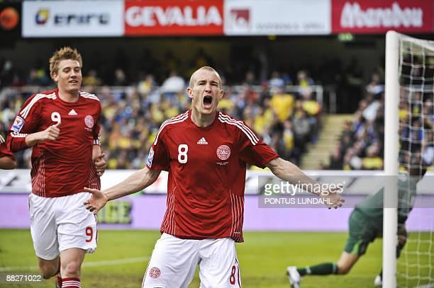 Denmark's Thomas Kahlenberg jubilates as his teammate Niklas Bendtner runs behind him after scoring 01 against Sweden in the World Cup 2010...