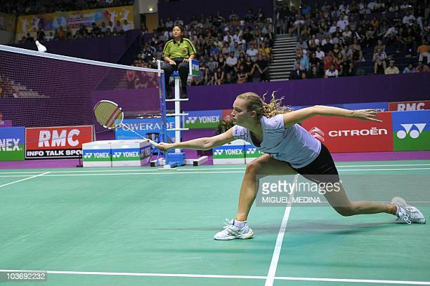 Denmark's Tine Baun competes against China's Wang Lin as part of the women's simple semifinals of the Badminton World Championships 2010 on August 28...