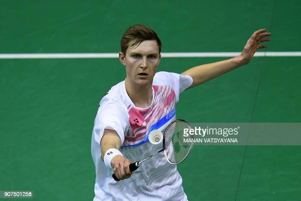 Denmark's Viktor Axelsen hits a return against Malaysia's Daren Liew during their men's singles semifinal match at the 2018 Malaysia Masters...