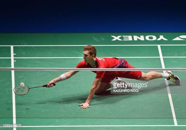 Denmark's Viktor Axelsen returns a shot against Japan's Kento Momota during the men's semifinal match at the Japan Open Badminton Championships in...