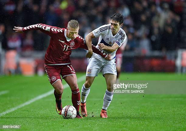 Denmark's Viktor Fischer vies for the ball with Armenia's David Manoyan during the World Cup 2018 football qualification match between Denmark and...