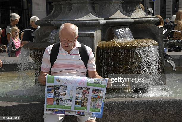 Travelers and shoppers window shoping and studing city may at stroke fountain amager torv on stroeget 08 Auguest 2014