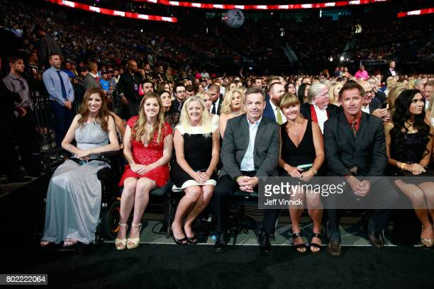 Denna Laing far left family guests and former NHL player Bobby Carpenter second from right sit in the front row during the 2017 NHL Awards Expansion...