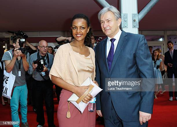 Dennenesch Zoude and Berlin mayor Klaus Wowereit arrive for the Escada Show at the MercedesBenz Fashion Week Spring/Summer 2013 on July 4 2012 in...