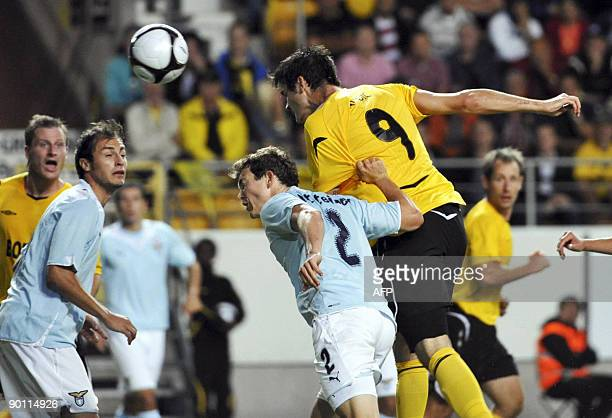 Denni Avdic of Elfsborg heads the ball to score 1-0 against Lazio, as Lazio's Stephan Lichtsteiner tries to stop him during their UEFA Europa League...