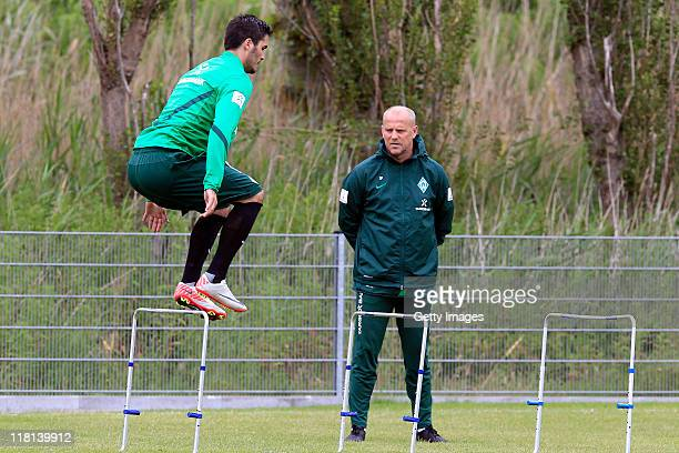 Denni Avdic practices next to head coach Thomas Schaaf during the SV Werder Bremen training session on July 4 2011 in Norderney Germany