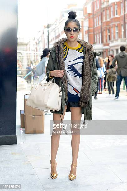 Denni Elias Fashion blogger, wearing Louis Vuitton shoes, Topshop coat, Phillip Lim sweater, Puma shorts, Givenchy bag, Prabal Gurung sunglasses on...