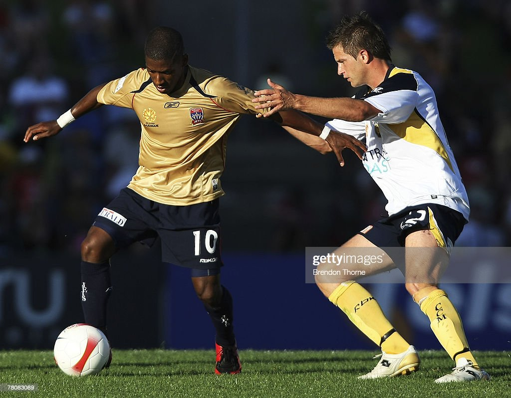 Denni of the Jets competes with Greg Owens of the mariners during the round 14 A-League match between the Newcastle Jets and the Central Coast Mariners at EnergyAustralia Stadium on November 25, 2007 in Newcastle, Australia.