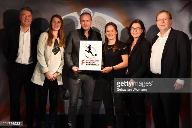 Denni Strich Isabella Hartig Thorsten Fischer Nicole Rolser Heike Ullrich and Rainer Koch DFB Vice President pose with the new Sponsor Logo of the...