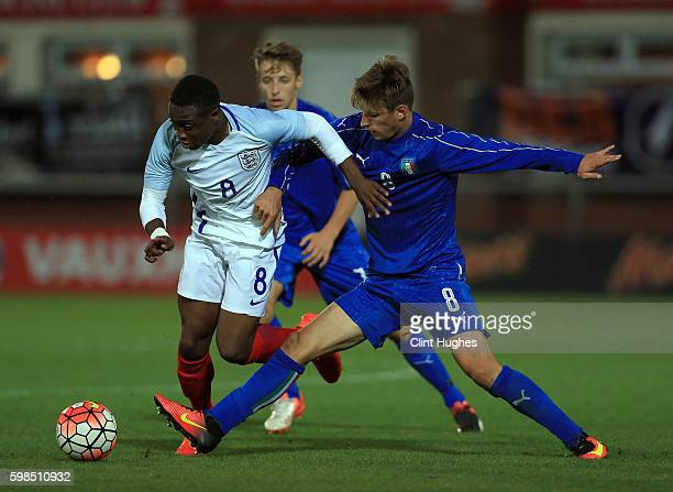 Dennis Adeniran of England U18 is tackled by Matteo Gabbia of Italy U18 during the international friendly match between England U18 and Italy U18 at...