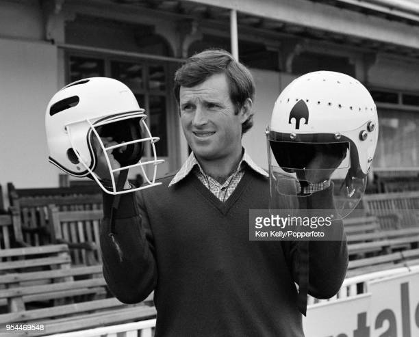 Dennis Amiss of Warwickshire and England with two of his batting helmets at Edgbaston Birmingham 13th June 1978 Amiss was a pioneer of the cricket...