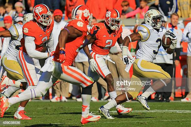 Dennis Andrews of the Georgia Tech Yellow Jackets runs the ball for a big gain during the second half against the Clemson Tigers at Bobby Dodd...