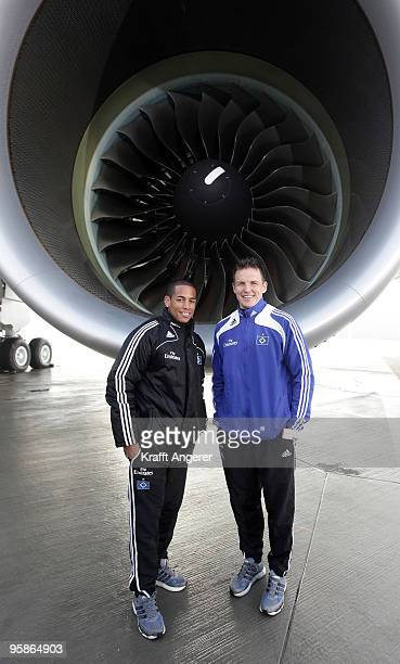 Dennis Aogo and goalkeeper Frank Rost pose in front of the engine during the hand over of the A380 to the Emirates airline on January 18 2010 in...