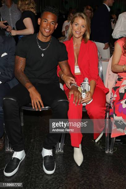 Dennis Aogo and Ina Aogo at the Marc Cain fashion show during the Berlin Fashion Week Spring/Summer 2020 at Velodrom on July 02 2019 in Berlin Germany