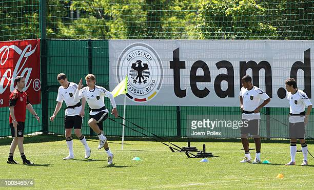 Dennis Aogo and Mesut Oezil of Germany exercise during a training session at Sportzone Rungg on May 23 2010 in Appiano sulla Strada del Vino Italy