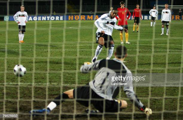 Dennis Aogo of Germany scores the first goal from the penalty spot past goalkeeper Kenny Steppe of Belgium during the friendly match between U21 of...