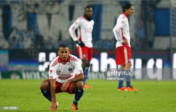 Dennis Aogo of Hamburg and his team mates look dejected after the Bundesliga match between Hamburger SV and FC StPauli at Imtech Arena on February 16...