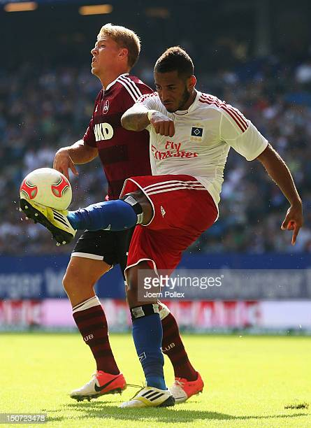 Dennis Aogo of Hamburg and Mike Frantz of Nuernberg compete for the ball during the Bundesliga match between Hamburger SV and 1 FC Nuernberg at...