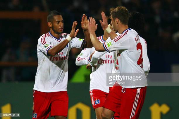 Dennis Aogo of Hamburg celebrates his team's second goal with team mates during the DFB Cup second round match between Eintracht Trier and Hamburger...