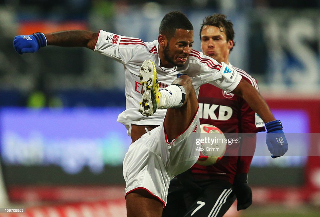 Dennis Aogo (front) of Hamburg is challenged by Markus Feulner of Nuernberg during the Bundesliga match between 1. FC Nuernberg and Hamburger SV at Easy Credit Stadium on January 20, 2013 in Nuremberg, Germany.