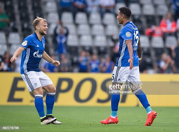 Dennis Aogo of Schalke celebrates his team's first goal with team mate Johannes Geis during the DFB Cup match between FC 08 Villingen and FC Schalke...