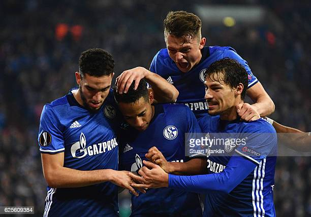 Dennis Aogo of Schalke celebrates with team mats as he scores their second goal from a penalty during the UEFA Europa League Group I match between FC...