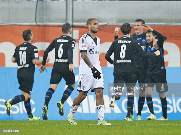 Dennis Aogo of Schalke looks dejected while players of Paderborn celebrate their teams first goal in the background during the Bundesliga match...