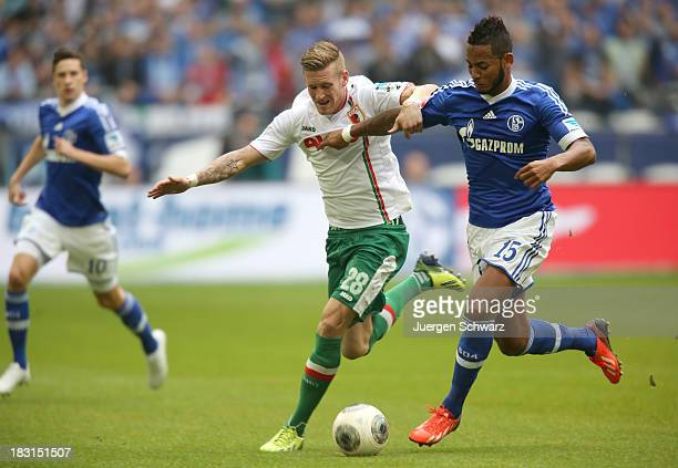 Dennis Aogo of Schalke R and Andre Hahn of Augsburg fight for the ball during the Bundesliga match between FC Schalke 04 and FC Augsburg at...
