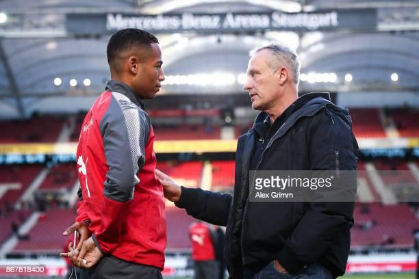 Dennis Aogo of Stuttgart and Head Coach Christian Streich of Freiburg talk prior the Bundesliga match between VfB Stuttgart and SportClub Freiburg at...