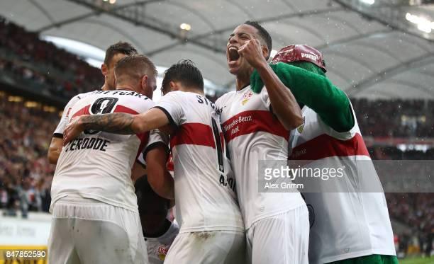 Dennis Aogo of Stuttgart and player of Stuttgart celebrate the goal of Chadrac Akolo of Stuttgart during the Bundesliga match between VfB Stuttgart...