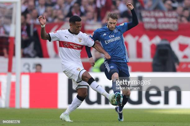 Dennis Aogo of Stuttgart fights for the ball with Aaron Hunt of Hamburg during the Bundesliga match between VfB Stuttgart and Hamburger SV at...