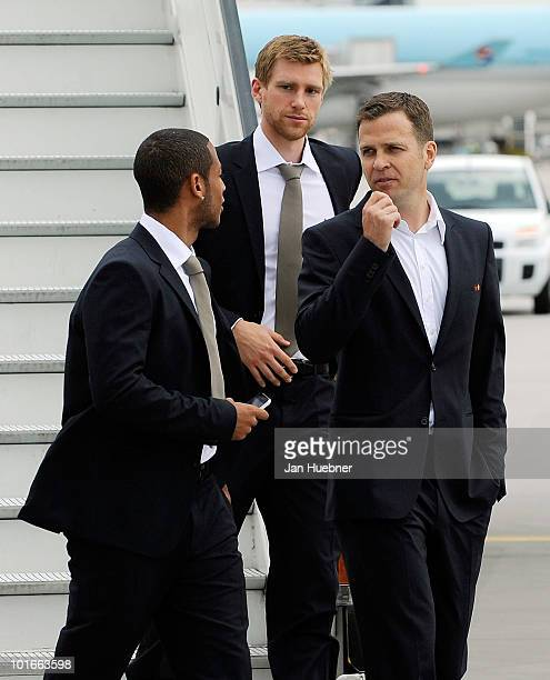 Dennis Aogo Per Mertesacker and team manager Oliver Bierhoff arrive at the airport before leaving for the FIFA Football World Cup 2010 in South...