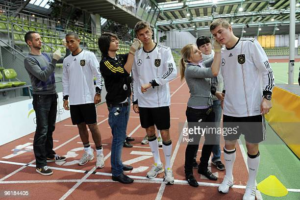 Dennis Aogo Thomas Mueller and Toni Kroos of the German national football team are seen during the taking of a blood sample during a fitness test at...