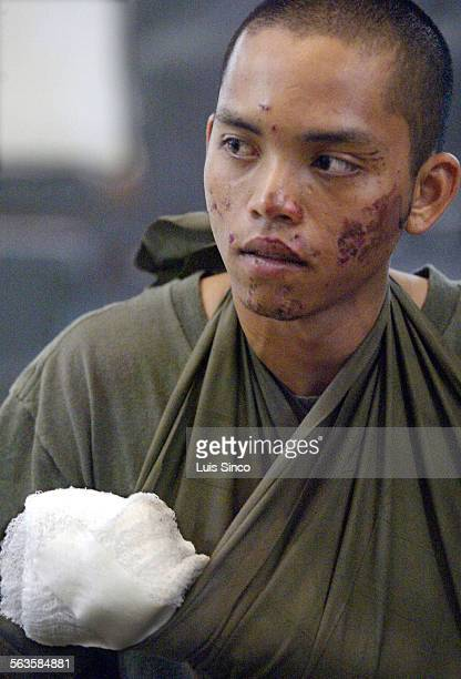 Dennis Astor a Navy medic whose family moved from the Philippines to San Diego County five years ago attends a memorial service for eight Marines who...