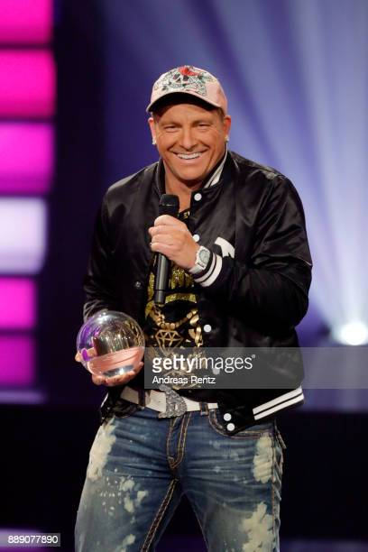 Dennis aus Huerth poses with his award 'Comedy Krone' on stage during the 1Live Krone radio award at Jahrhunderthalle on December 07 2017 in Bochum...