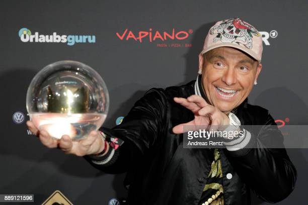 Dennis aus Huerth poses with his award during the 1Live Krone radio award at Jahrhunderthalle on December 07 2017 in Bochum Germany