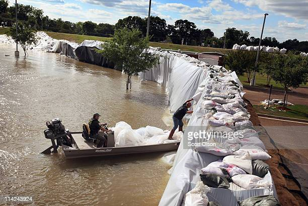 Dennis Barkemeyer inspects a levee constructed around a medical center to hold back floodwater from the Mississippi River May 16 2011 in Vidalia...