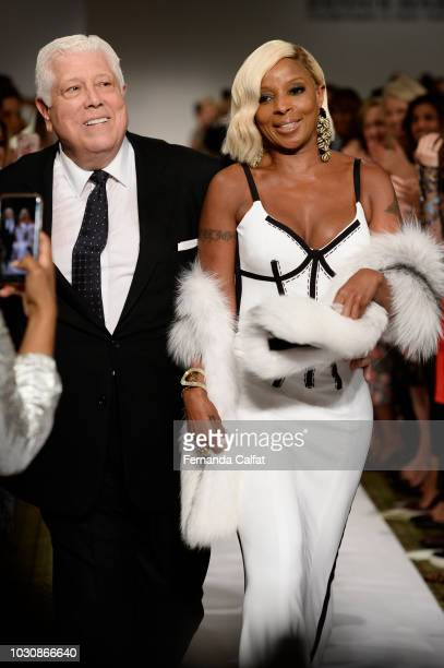 Dennis Basso and Mary Jane Blige walk at Dennis Basso Runway September 2018 at New York Fashion Week at Cipriani 42nd Street on September 10 2018 in...