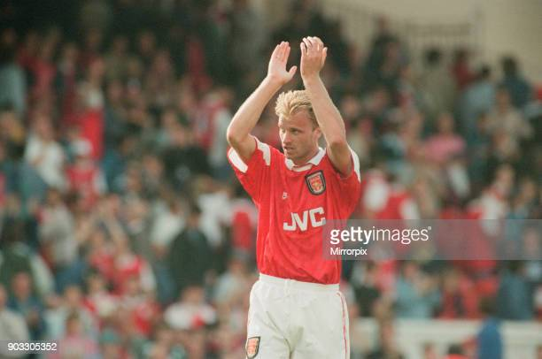 Dennis Bergkamp celebrates and applauds the fans for their support for his teams victory over Southampton at the end of the match Dennis scored his...