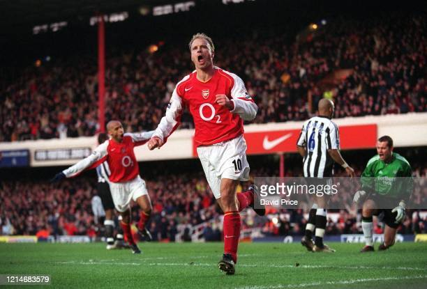 Dennis Bergkamp celebrates scoring a goal for Arsenal during the Premier League match between Arsenal and Newcastle United on January 23 2005 in...