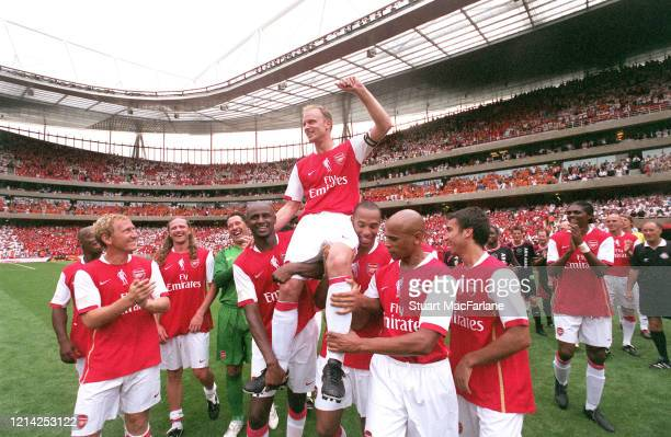 Dennis Bergkamp is chaired by his former teammates Patrick Vieira and Thierry Henry after the Dennis Bergkamp Testimonial between Arsenal XI and Ajax...