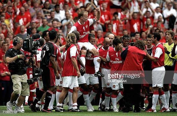 Dennis Bergkamp is hoisted onto teammates shoulders after a testimonial match at Emirates stadium in north London 22 July 2006 The match played in...